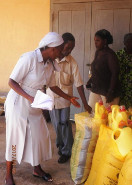 Distribution of hunger relief campaign food supplies by the catholic sisters near Baharini. Image 4/5.